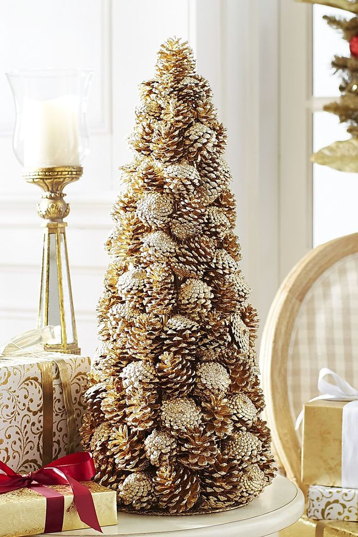 How does Pier 1's Glitter Pinecone Tree stack up? Quite naturally, actually. Sparkling beside your fireplace or greeting guests in the entryway, its woodsy handcraftsmanship and eye-catching gold glitter look natural together.