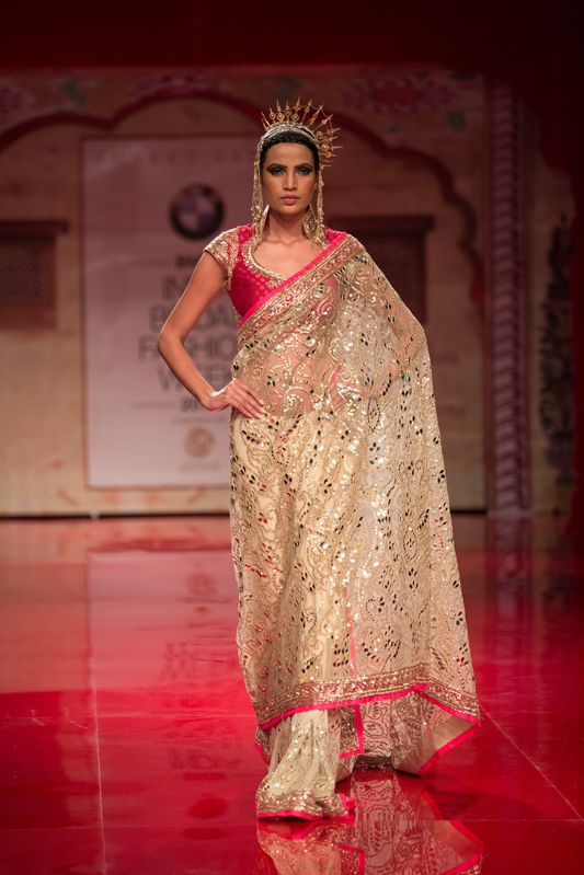 Pink and gold Indian bridal sari by Suneet Varma. More here: http://www.indianweddingsite.com/bmw-india-bridal-fashion-week-ibfw-2014-suneet-varma/