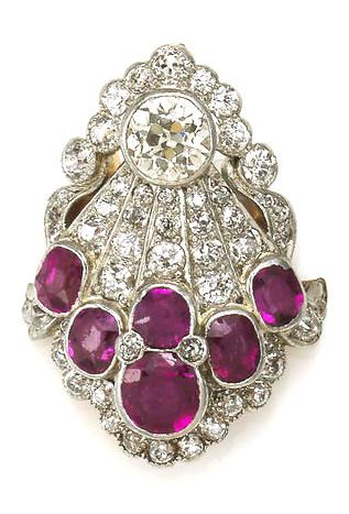 An art deco ruby and diamond jewelry component, circa 1925 composed of old European-cut diamonds and cushion and circular-cut rubies; rubies weighing approximately: 2.25 carats; central diamond weighing approximately: 0.75 carat; remaining diamonds weighing approximately: 1.10 carats total; mounted in platinum-topped fourteen karat gold; length: 1 1/8in.