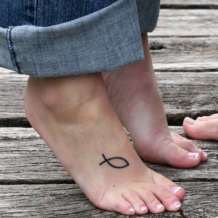 Woman with Jesus Fish Tattoo on Foot