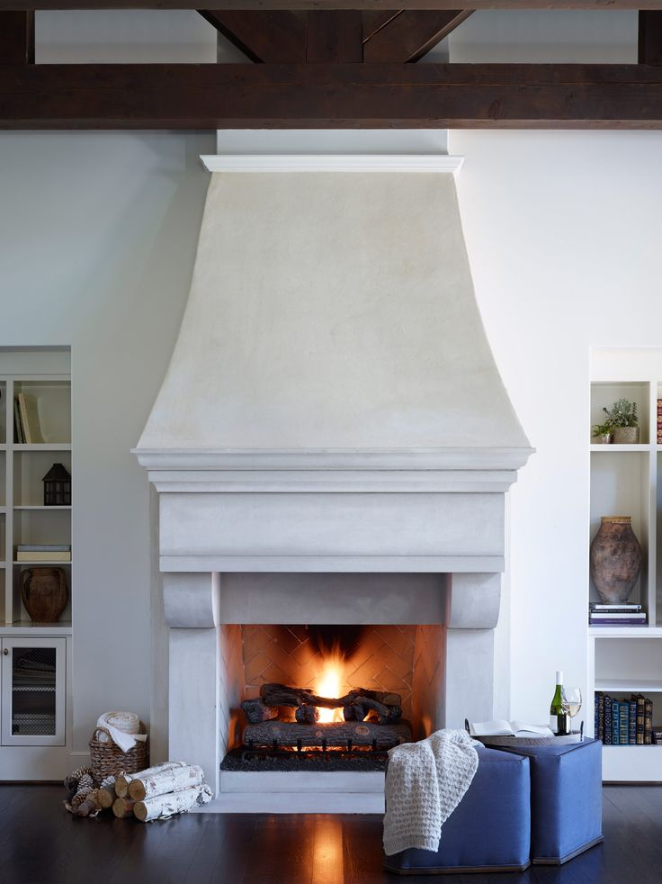 This custom fireplace in the Tudor style is a beautiful centerpiece in an otherwise simple design style.