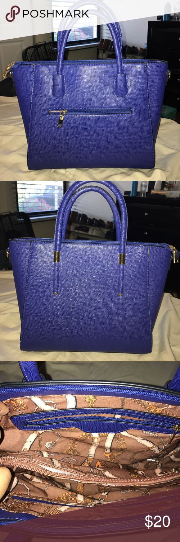 Large purple/blue purse Beautiful Purple/Blue purse with gold zippers. 3 inside pockets and 1 large theft proof zipper section. I bought the bag at TJ Max and don't know the brand (no labels on it). Like new! Bags Shoulder Bags