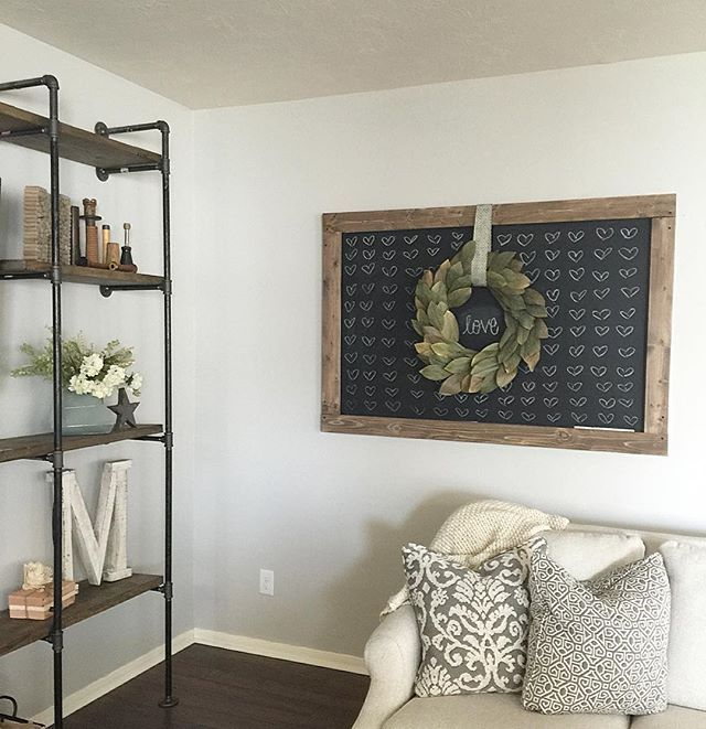 """Added some """"love"""" to my big chalkboard and a new big letter to my industrial shelving! Those big white wooden letters are on clearance at Hobby Lobby right now! I couldn't pass it up. Sounds like you may need one @whiteandwoodblog , they're white & wooden ;) hope everyone is having a great Friday!  #homedecor #livingroom #blog #chalkboard #wreath #friday #bloomingnest #HarperAndArrowBrandRep"""