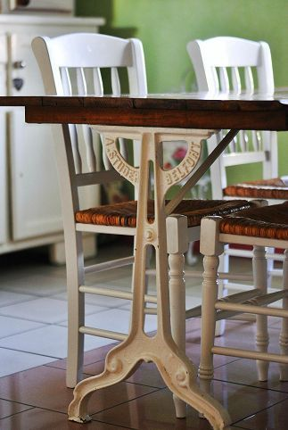 legs of a trestle sewing machine up cycled as a base for a dining table. beautiful ideas. Home Design Ideas