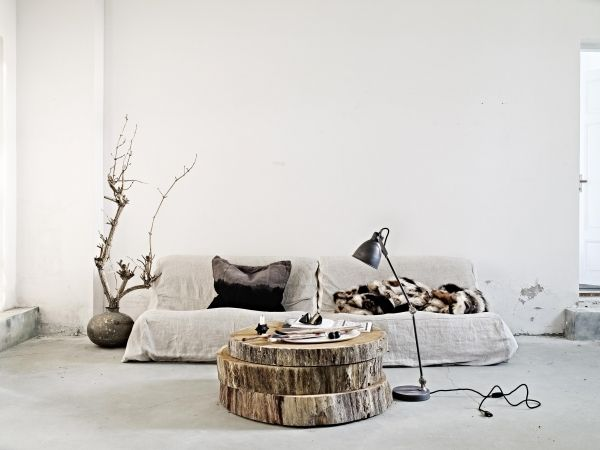 big slices of a tree trunk for a coffee table