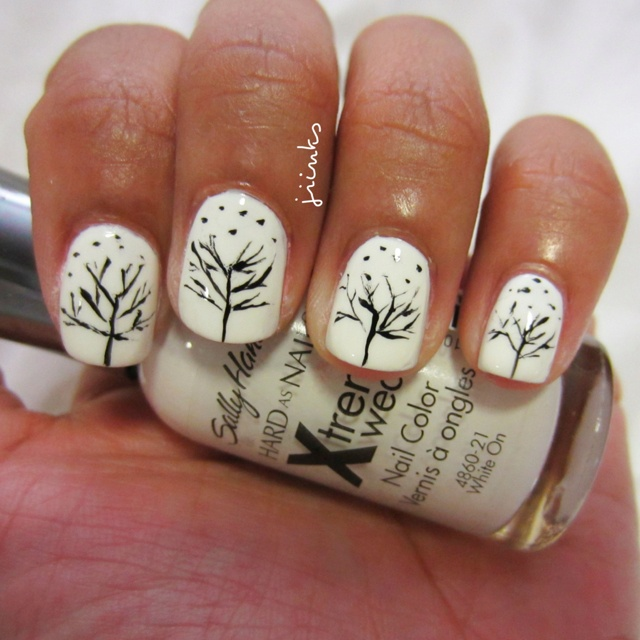"""I have a thing for winter trees. """"White On"""" by Sally Hansen! I used a black nail art polish to create the trees."""