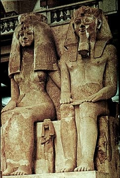 Pharaoh Amunhotep III and Queen TIye in the main entry way of the Cairo Museum.