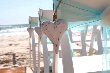 Eternal Weddings Décor and Photography.Gold Coast.Beach Wedding.Heart Decoration.Blue Chair Sash.Bamboo aisle runner.White Americana Chairs