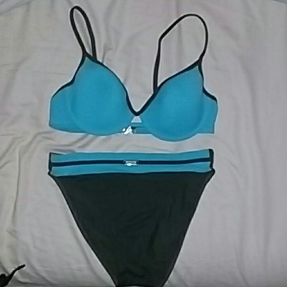 Sunflair 2 piece swimsuit Dark olive green and teal/robins egg blue swimsuit.  High waisted on hip.  Straps do not adjust but have option to cross straps in back.  Small clasp hooks together in back.  Like new,  only worn twice for a competition. sunflair Swim Bikinis