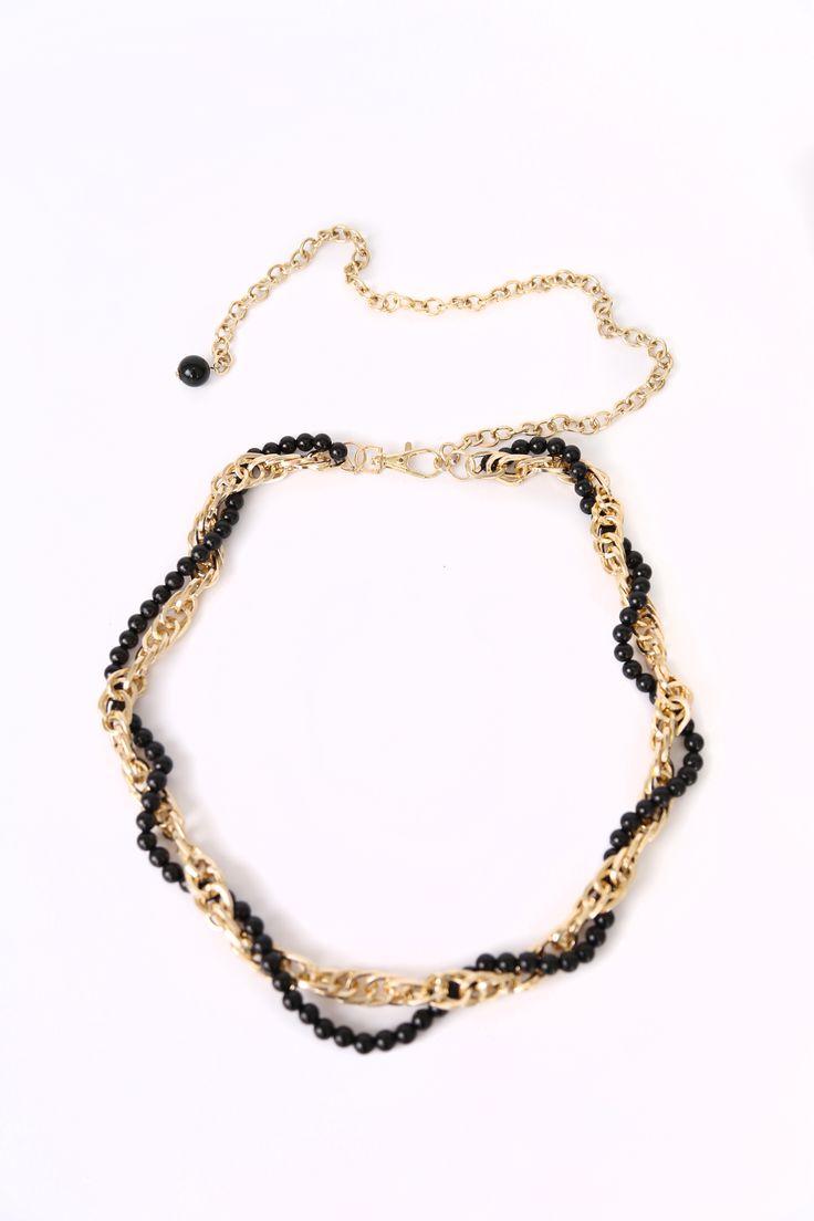 cinturón con perlas negras entrelazadas