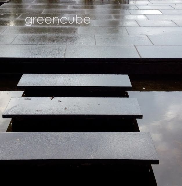 greencube garden and landscape design, UK Stepping stones appear to float over black reflective pool