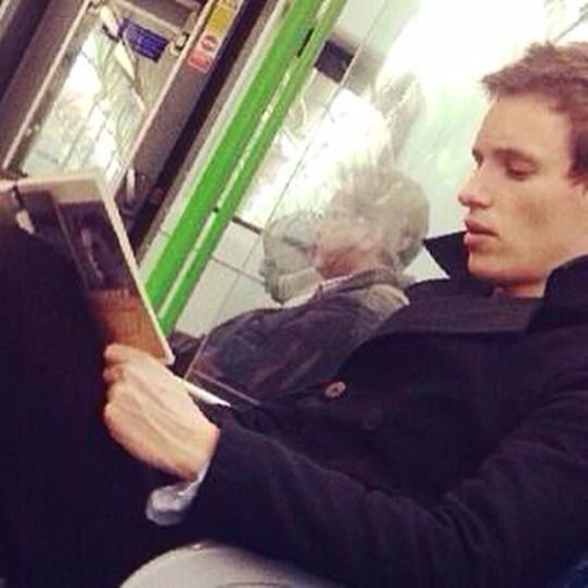 Eddie Redmayne reading The Danish Girl on the London Tube in April 2014.