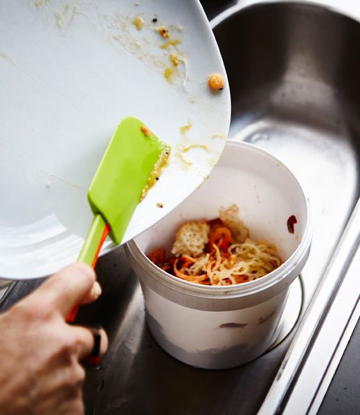 Leftover food being scraped off a plate...get a little food scrap bucket and scraping spatula for the sink area.