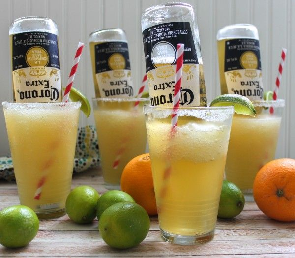 5 C Ice, 1 C Tequila, ½ C Grand Marnier, 5 Limes, more for garnish, 1 Orange, 1 C simple syrup, 6 Corona  Juice the limes and the orange in a large measuring cup, then add in the tequila, grand marnier, and simple syrup. Blend ice and margarita mixture. Pour the frozen margarita into a salt-rimmed glass, pop open a Corona, and place it upside down in the glass, submerging it into the margarita.