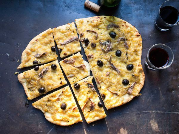 According to Jacques Medecin, former mayor of Nice and an authority on its cuisine, the layer of onions on a pissaladiere should be half as thick as the crust.