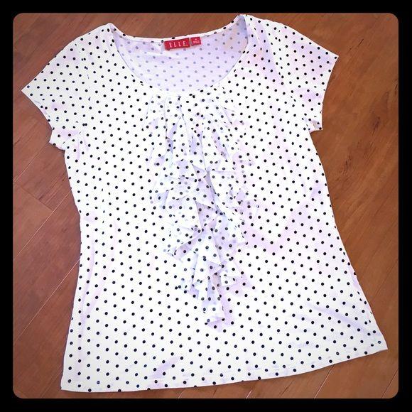 ✨ELLE Black/White Polka Dot Top ELLE NWOT white top with black polka dots.  Ruffle detail down front.  Body: 60% Pima cotton, 40% modal; Ruffle: 100% polyester.  Machine washable.  Brand new without tags! Elle Tops