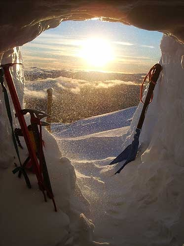 Sunrise view from a snow cave - I'M PRETTY SURE THIS IS WHAT YOU WAKE UP TO EVERY MORNING IF DIE AND GO TO HEAVEN
