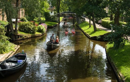 """The village Giethoorn known as the """"Venice of the Netherlands"""" was founded in 1230 and resembles some of the most beautiful fairytale passages. The stunning oddity contains no roads or modern transportation. With the help of canals and 176 bridges, people are able to navigate through its wonders."""
