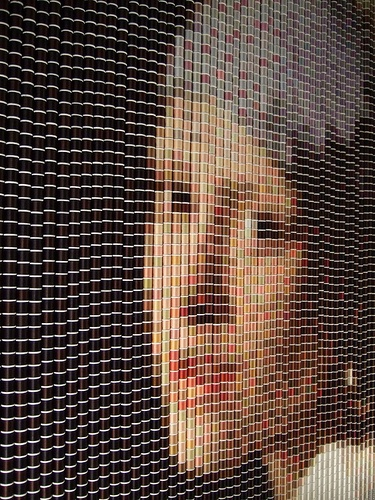 Girl with a Pearl Earring - made of spools of thread by Devorah Sperber,  Photographed in a Pittsburgh art gallery