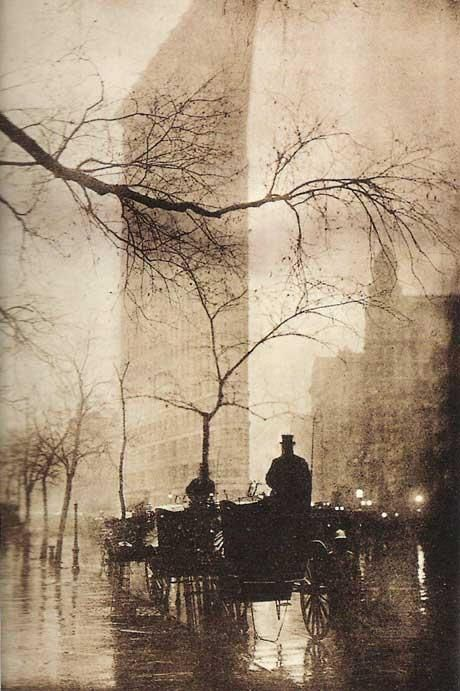 Edward Steichen: The Flatiron, 1904  The Flatiron is the quintessential study of twilight. Clearly indebted in its composition to the Japanese woodcuts that were in vogue at the turn of the century and in its coloristic effects, to the Nocturnes of Whistler, this picture is a prime example of the conscious effort of photographers in the circle of Alfred Stieglitz to assert the artistic potential of their medium.