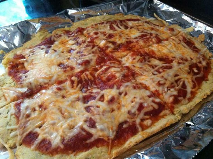 Brown rice pizza crust  2 cups brown rice flour 4 large eggs 1 cup shredded cheese of your choice 2 tbsp olive oil 2 tsp garlic powder 1 tsp oregano 1/4 tsp sea salt Sauce, cheese, and other toppings