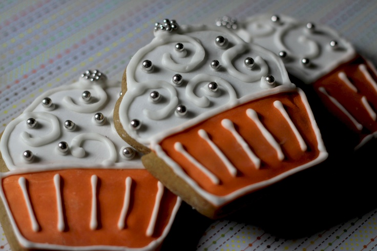 Vanilla cupcake cookies decorated with fondant and royal icing.