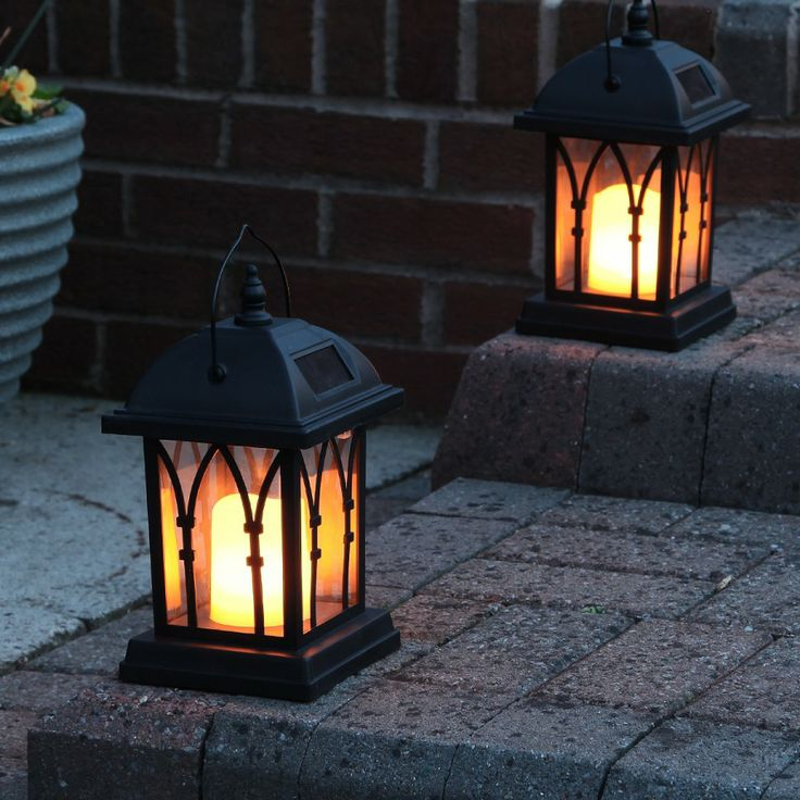 Black Flickering #Solar #Candle #Lantern - Perfect for a summers evening in the garden, or light up a stair way like in this picture!