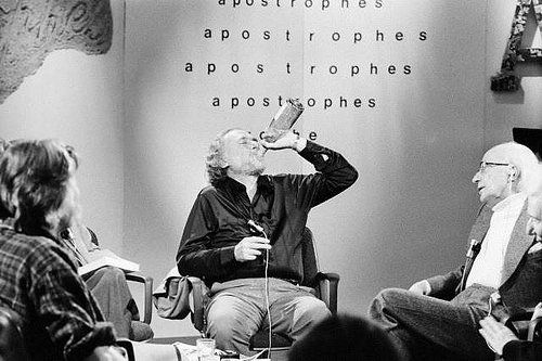 Charles Bukowski drinking on the set of the French TV program Apostrophes hosted by Bernard Pivot 1978