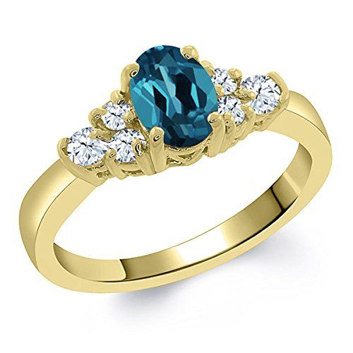 0.79 Ct Oval London Blue Topaz White Topaz 925 Yellow Gold Plated Silver Ring