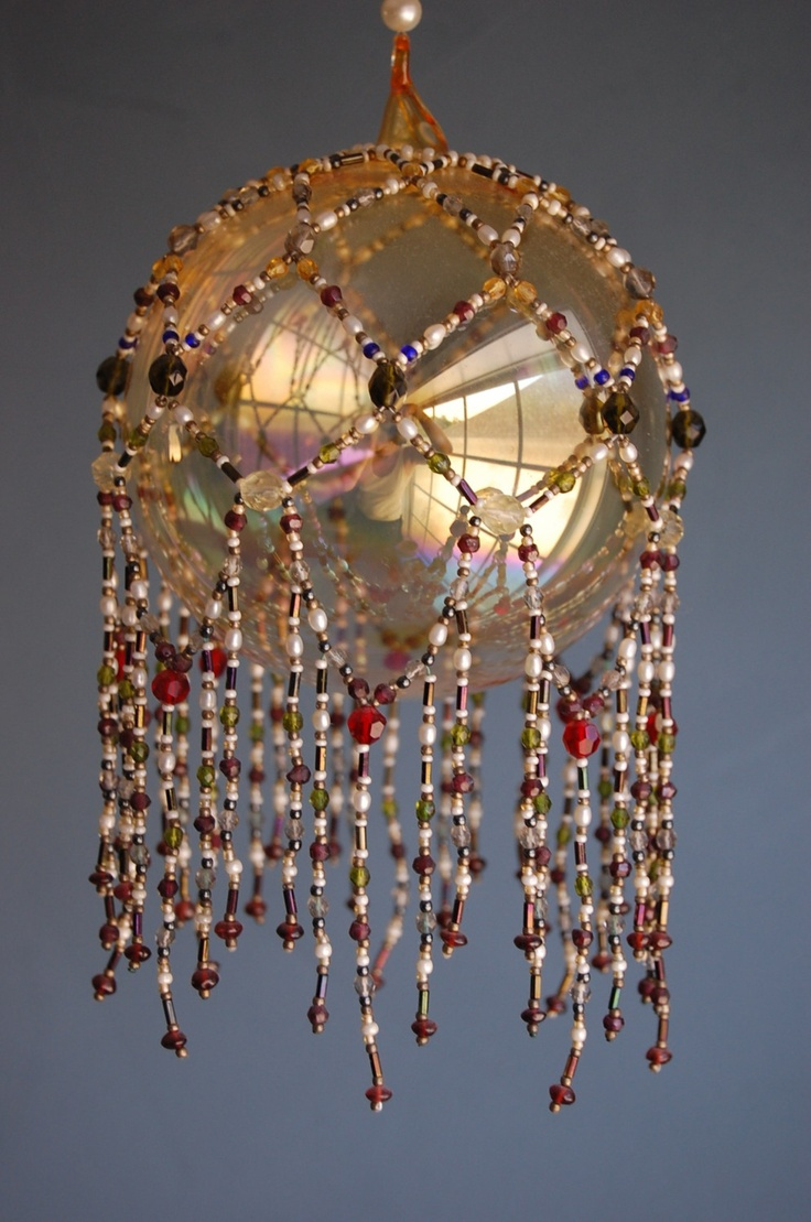 Beaded overlay for glass ball.  Beautiful.