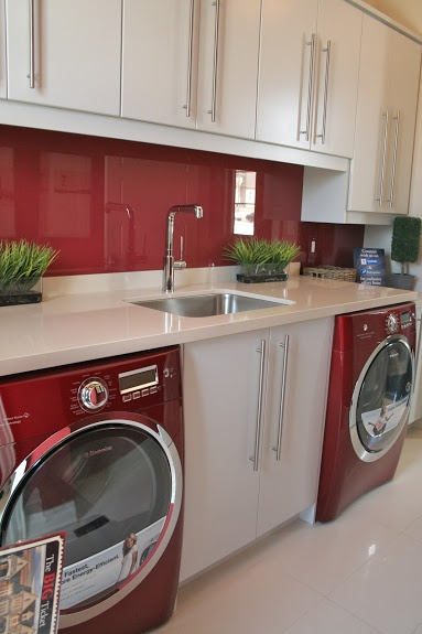 red laundry appliances (like ours)  I love how these appliances look in this laundry room
