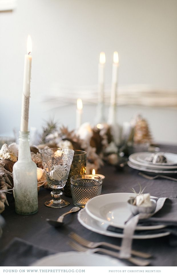 table setting - dark grey linens, textured glassware, clouded glass - add ferns and other dark greens and poppys, maybe some herbs, stone or clear crystal placecards with copper wire, poppy or fiddle fern with a cream ribbon on setting.. pops of gold