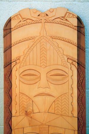 """Shwiqhiq Pi mun"" (Frog and Moon), a Chinookan power board donated to Clatsop Community College, was part of CCC's ""Pacific Rim Art Exhibit: Emergence from Place – Neo-Traditional Indigenous Art"" held in spring 2012. Hand-carved from red and yellow cedar by Chinook tribal member Greg Robinson, the board now resides in the upper entry to Columbia Hall at CCC."