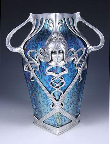 ellentarii:  Loetz Art Nouveau Iridescent Glass Vase with Pewter Mount