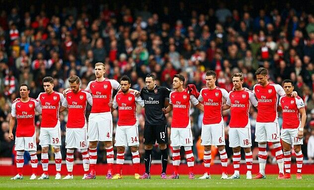 26 April 2015: Arsenal players mark the anniversary of the Bradford City fire disaster with a minute's silence, before their game against Chelsea at the Emirates Stadium...