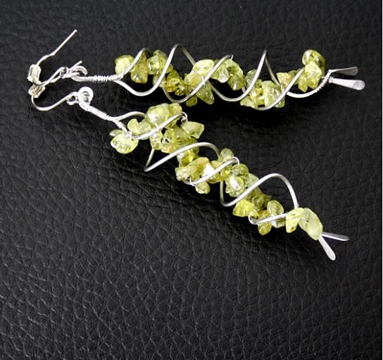 Earrings made with two wire spirals and semi-precious chips..Great idea.