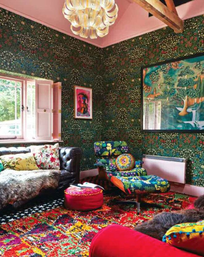 """""""Walls are covered floor to ceiling with William Morris 'Blackthorn' while the eames lounger is upholstered in a contemporary floral design. All the windows have … Read More"""