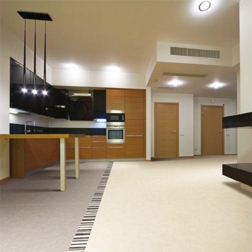 Porcel-Thin TOSCA cream and mocha concrete effect porcelain floor tiles in a large modern kitchen.  #modern #kitchen #tiles