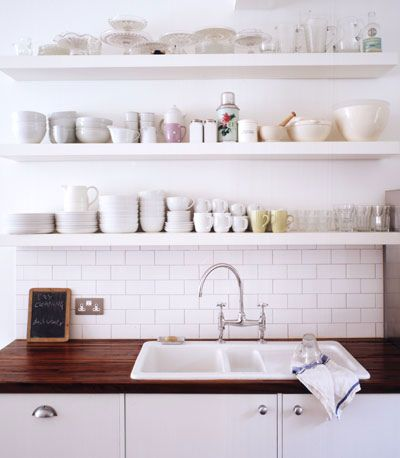 White brick wall-extend the shelves right over the pass through!