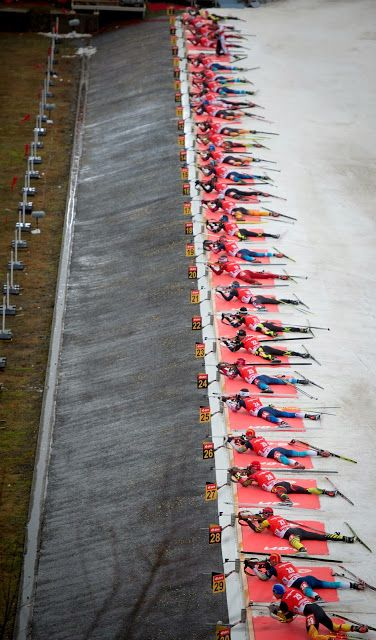 Biathletes shoot during the men's 15 km mass start event of the IBU Biathlon World Cup 2014 in Oberhof, eastern Germany. Martin Fourcade of France won the event ahead of Alexey Volkov (2nd) of Russia and Tarjei Boe (3rd) of Norway.