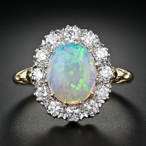 Opal halo ring, done in the Victorian style. 18K gold, 1.50 carat opal and 12 European cut diamonds, 0.80 tcw, VS1-SI1/G-H