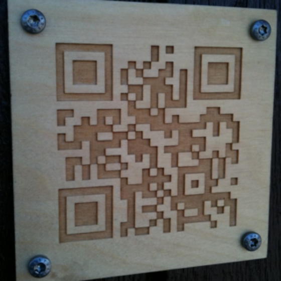 Hand carved QR code in wood