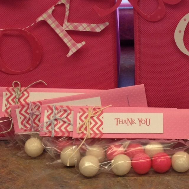 Gum ball favors with a sign that says thanks for celebrating with ____ before she pops. Love it!