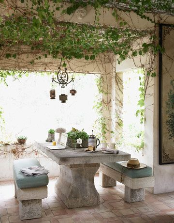 Weathered character comes naturally to Bianchi's open-air loggia. Ivy creeps in behind curtains made from old French linen sheets; the antique Italian table rests on handmade Mexican terra-cotta pavers (which are installed with radiant heat.)  Wow!!