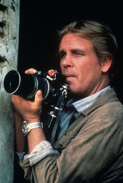 Under Fire (1983) The photographer: Handling a Nikon F2 like a pro is tougher than it looks, but Nick Nolte gets it exactly right, even showing us a bit of manual rewinding at times. Maybe this is thanks to the influence of the film's advisor Matthew Naythons, who'd worked as a photojournalist in wartorn Nicaragua. Just ignore the extra on the hotel roof – he's not so handy with his video camera!