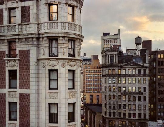 Gail Albert Halaban (American, b. 1970) Out My Window, Chelsea, 20 West 29th Street, Ace Hotel, Woman Cleaning Window, Last Room of the Day, 2010 ©Gail Albert Halaban/Courtesy of Edwynn Houk Gallery