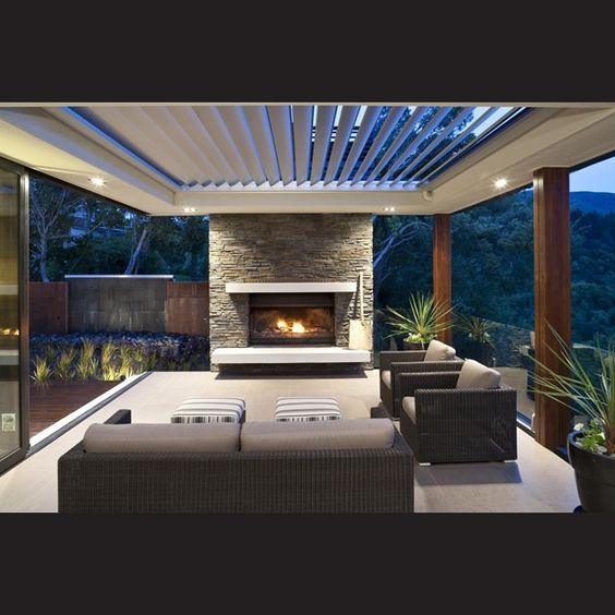Tall wooden posts carry through to support the veranda roof in the outdoor spaces.: