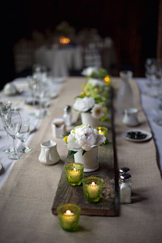Love the simple plank across the table. green votives, small slowers, burlap and plank wood
