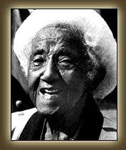 """Marjorie Stewart Joyner was born in Monterey, Virginia on 10/24/1896, the granddaughter of a slave and a slave-owner. In 1912, an eager Marjorie moved to Chicago, Illinois to pursue a career in cosmetology. Joyner developed her concept by connecting 16 rods to a single electric cord inside of a standard drying hood.  After 2 yrs. Joyner completed her invention and patented it in 1928, calling it the """"Permanent Waving Machine."""" She thus became the first Black woman to receive a patent."""