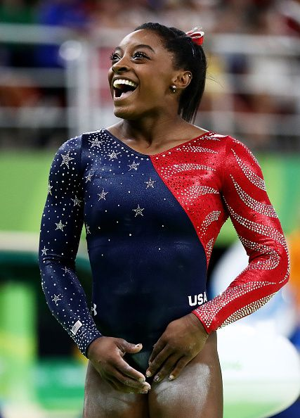 Simone Biles of the United States smiles before competing on balance beam during Women's qualification for Artistic Gymnastics on…